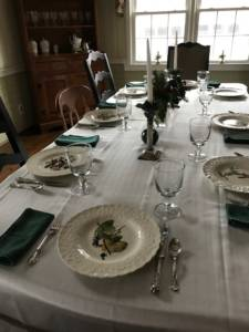 Image of table set with Audubon plates and white table cloth