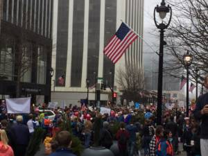Image of Women's March in Raleigh with crowd and American flag
