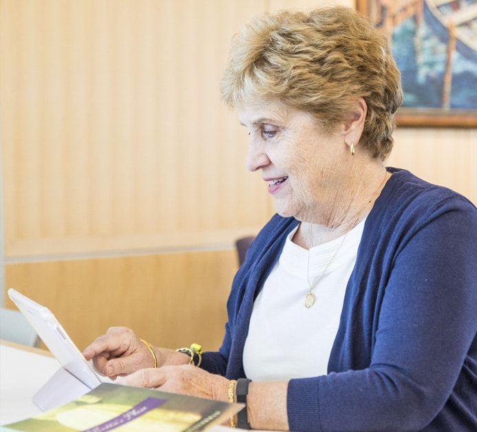 Katherine P. Stillerman working on tablet.